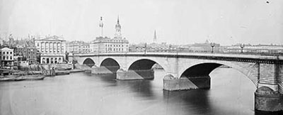 The Havasu London Bridge spanning the River Thames in London in the late 1800s.