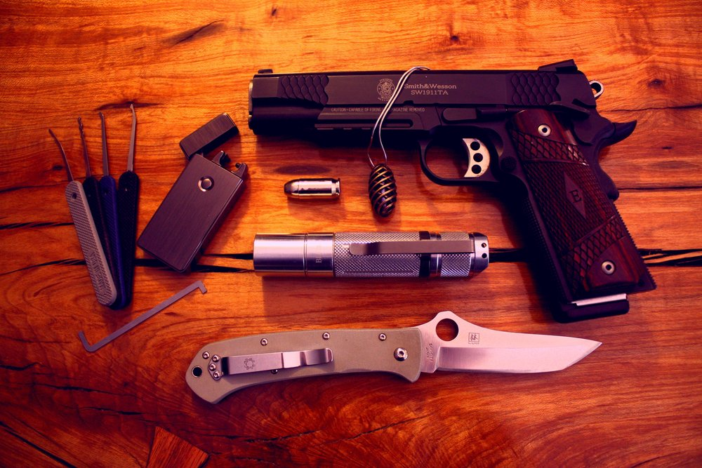 Peterson lockpicks, Custom BLF A6 modded to 2200 lumens, Tofty Tritium, Spyderco Lum Tanto Sprint, Tesla lighter, S&W .45ACP, Liberty Civil Defense