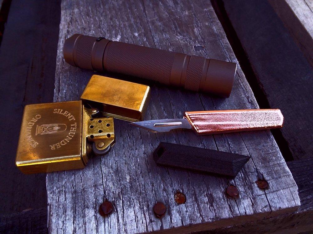 solid CNC machined brass STO lighter, custom FDE Convoy S2+, custom copper scalpeldashi w/ carbon fiber sheath