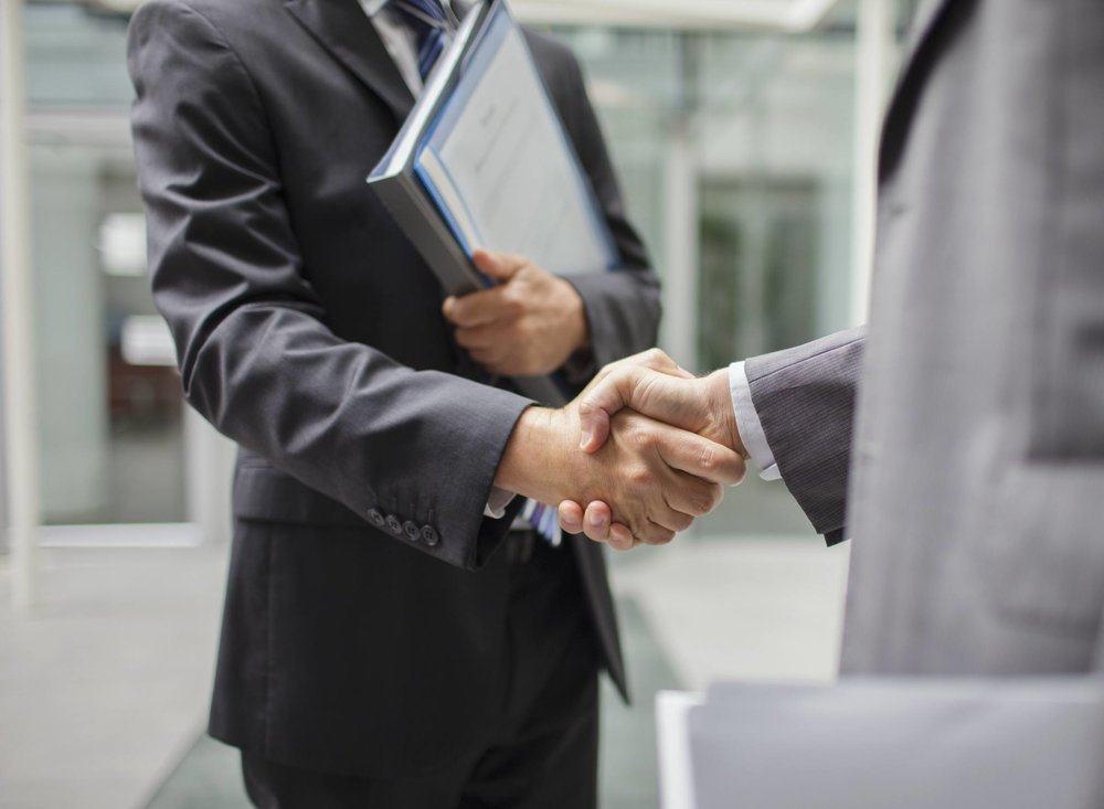 Firm-handshake-GettyImages-521811101-58db29763df78c5162605f22.jpg