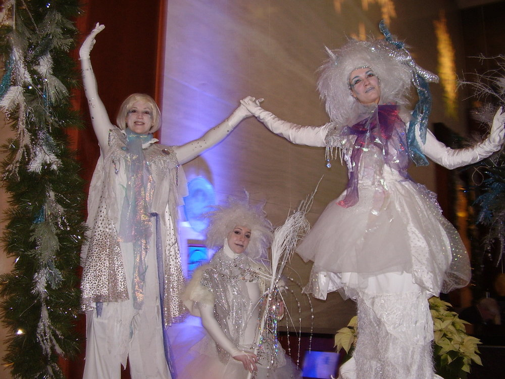 Snow stilt girls and statue.jpg