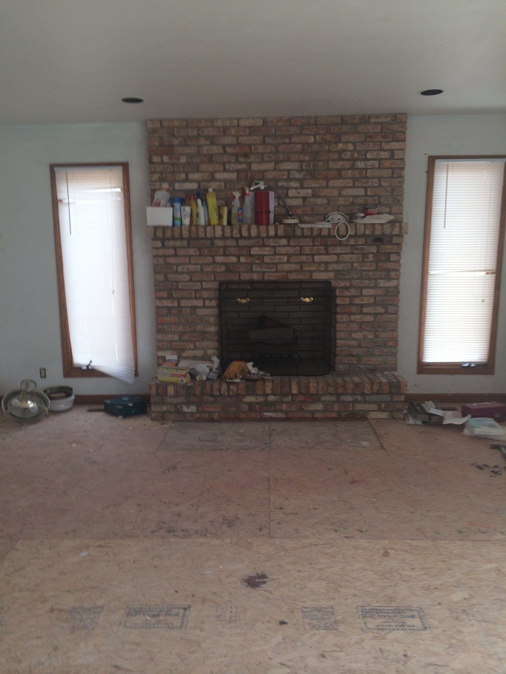 fireplace before white paint
