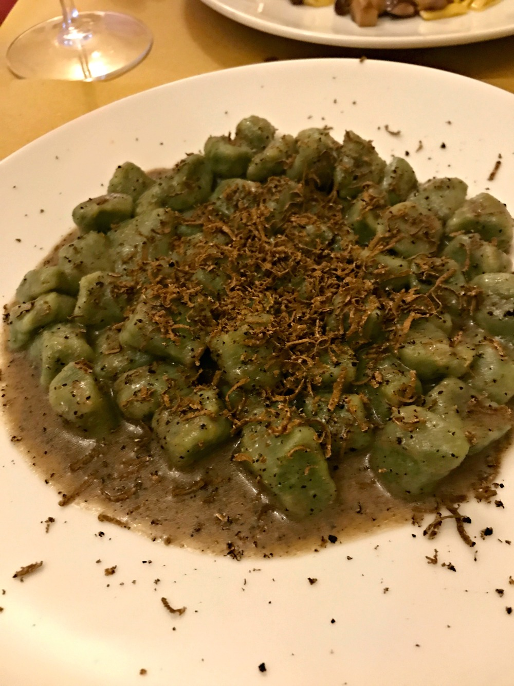 - Green nettle gnocchi with fresh truffles for me.