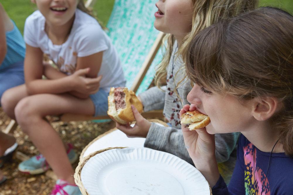 Kiddos eating burgers at our 2017 Inaugural Family Summer Camp.