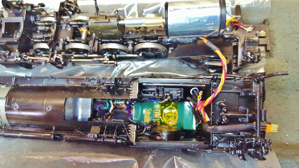 This is a Division Point NYC H10. We are using a WOW decoder. There are 4 specially modified Iphone 4S speakers in the boiler as well as Headlight, Class markers and Cab Light . A custom cam pick up is located under the motor. A Keep Alive is located in the tender.