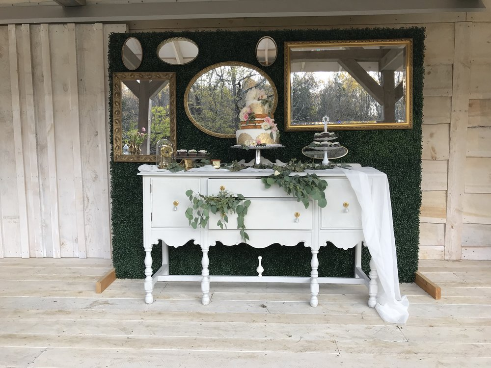 "boxwood wall with white buffet table (mirrors and cake display not ours) | Qty: 1  Boxwood Wall 8' 6"" tall ; 9' wide"