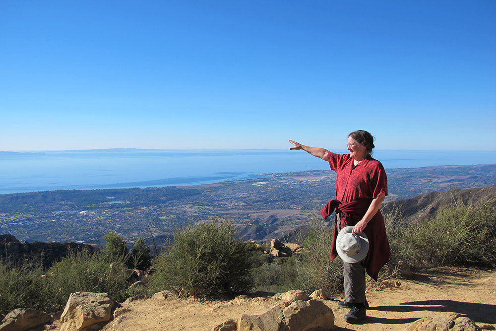 Tanya Atwater in Santa Barbara pointing to the northern Channel Islands