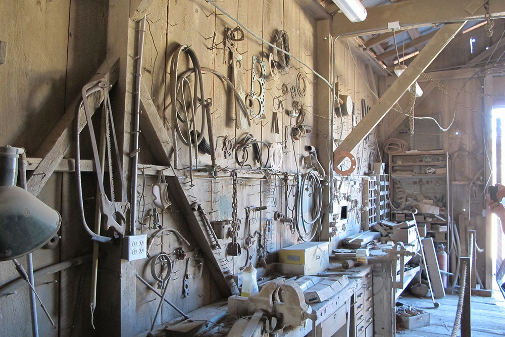 The ranch workshop, inside the red barn, looks operational although it was abandoned decades ago