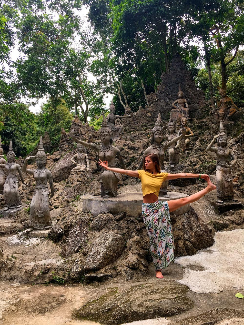 Utthita hasta padangusthasana among the Buddhas.