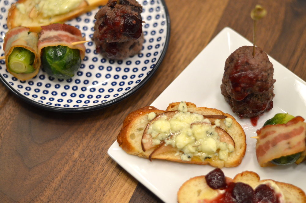 "Bacon-wrapped brussel sprouts, meatballs, and cranberry brie crostini from ""Swanky Holiday Cocktail Party"" in NYC for $27/person"