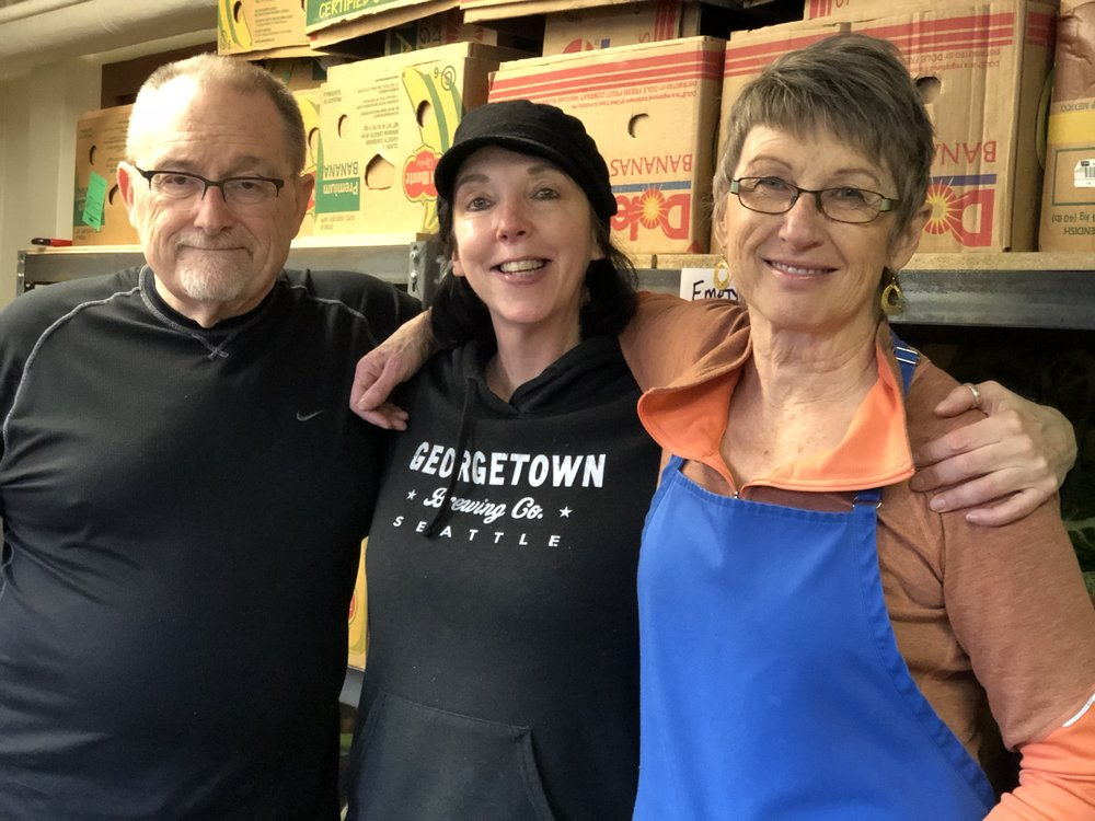 STEPHANIE monroney (R) with two of the food bank's dedicated volunteers.