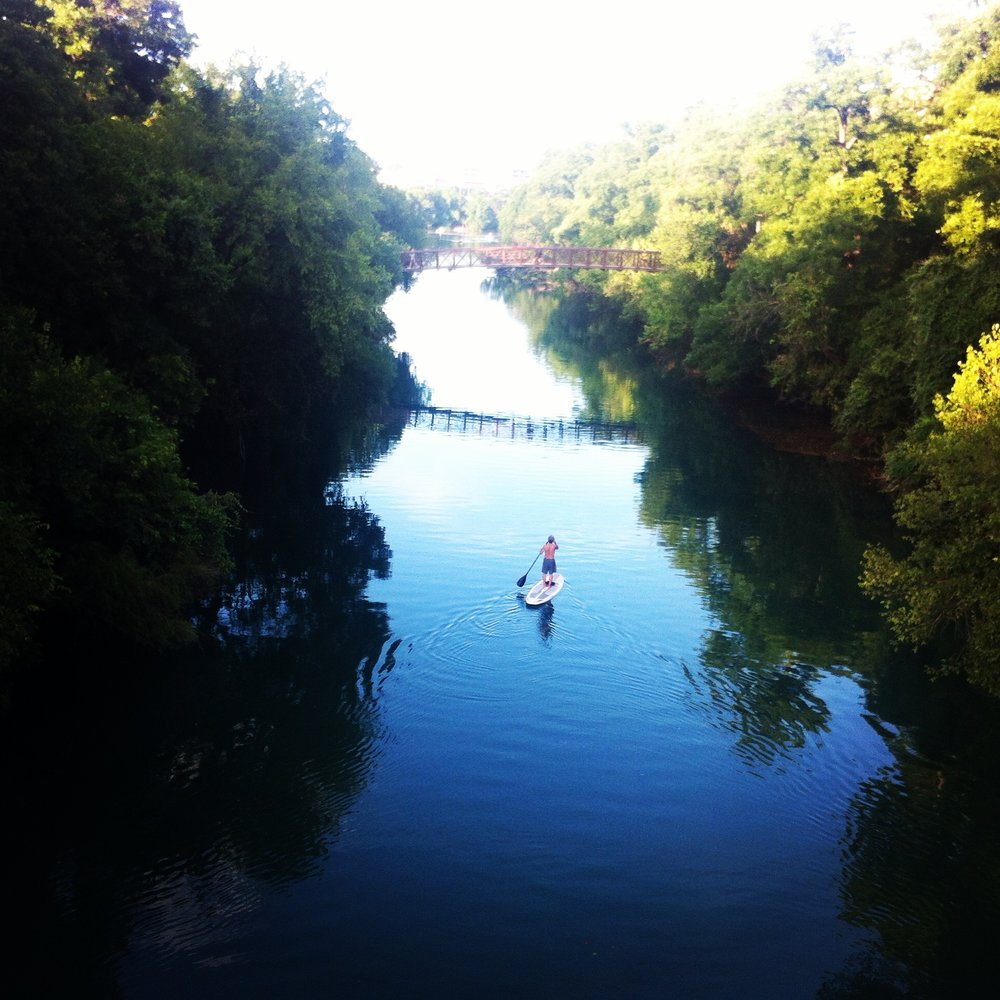 Lone paddleboarder on Barton Creek