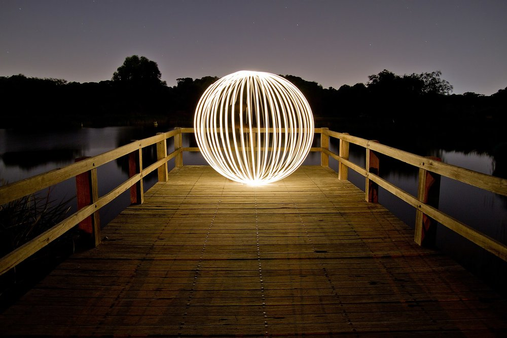 Light painting an orb in Booyeembara Park, Perth, Western Australia ,  by JJ Harrison (Creative Commons)
