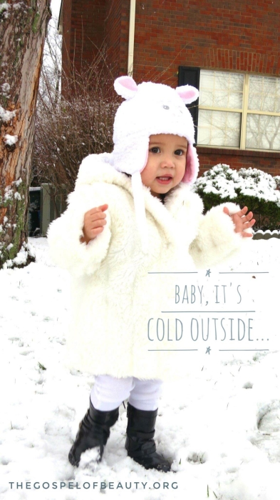 Ariana, nearly two years of age, was all bundled up while enjoying her first snow.