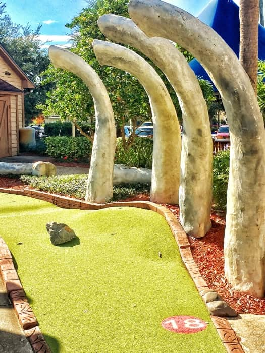 Who's ready to take a shot? hitting the 18th hole in the mini Golf course is dinosaur play.