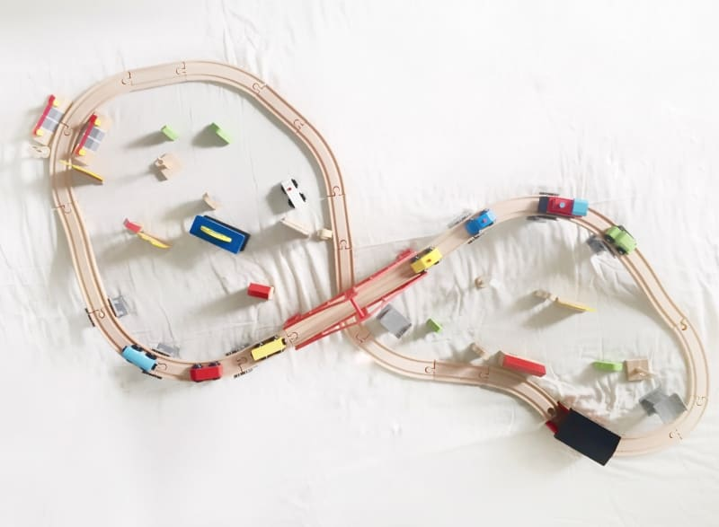 Current hands-on play obsession at home is this Cubbie Lee toy Company Wooden Train Set.