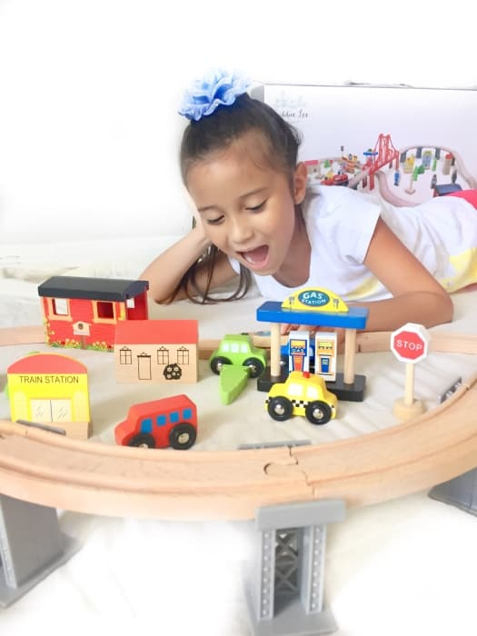 The joy on the little one's face after successfully building this train set says it all.