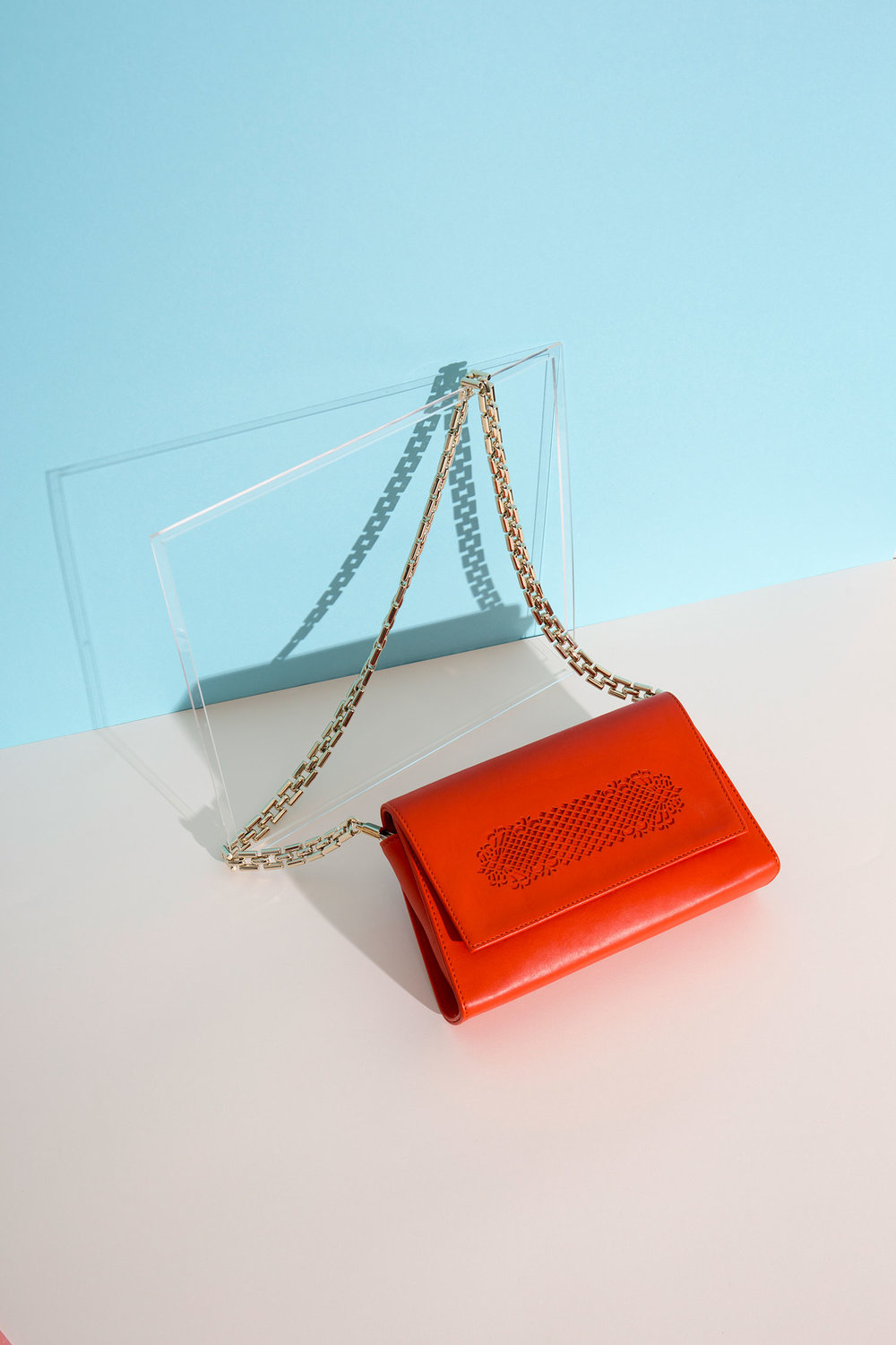 Web-4-Gold-Chain-orange-leather-clutch.jpg