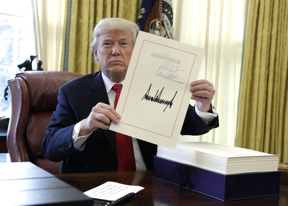 donald-trump-tax-bill-signature.jpg