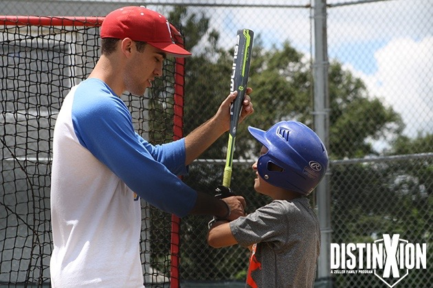 (Above) - Trent working with a baseball camper on his swing.