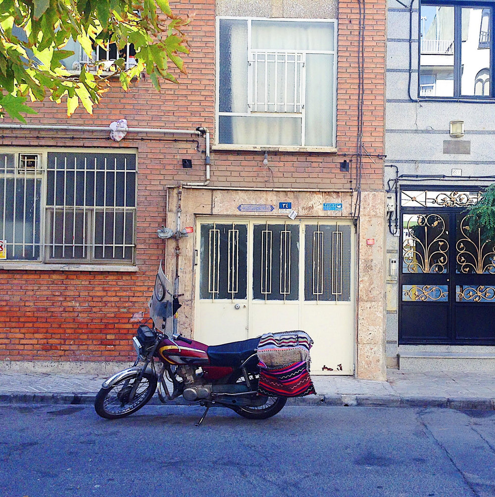 Solo parking in the Northern neighborhood of Tehran where we stayed. It was a bit far out but a very nice area, pretty quiet and really a suburb where people live, buy their groceries and go our for dinner and tea.