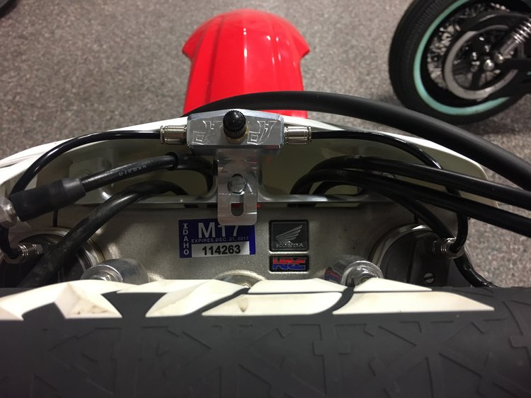 A top view for all Honda kits that come with the mounting bracket. The bracket is mounted the same place on the triple clamp as the number plate.