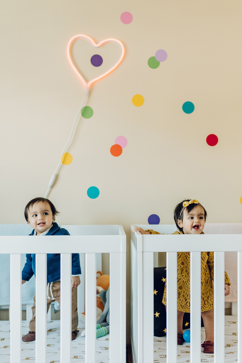 twins in a crib in CT by laura barr photography