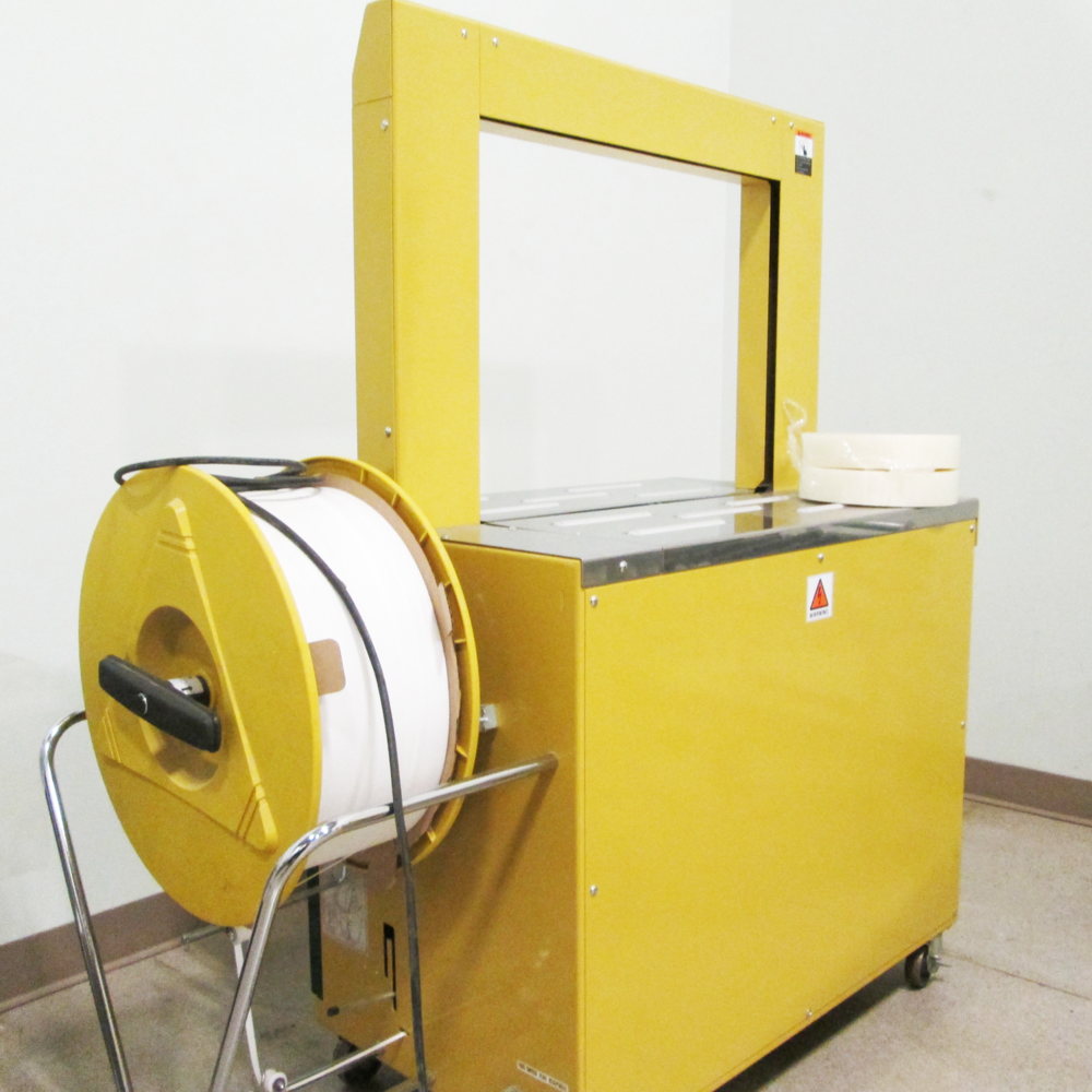 A Samuel RQ-8X Automatic Strapping Machine at Brampton Packaging Equipment Showroom.