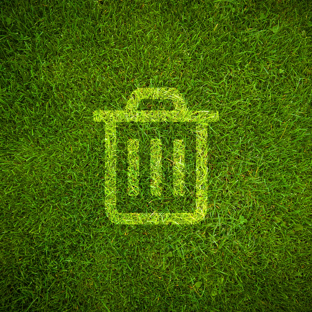 Garbage Can Icon on Green Grass Background