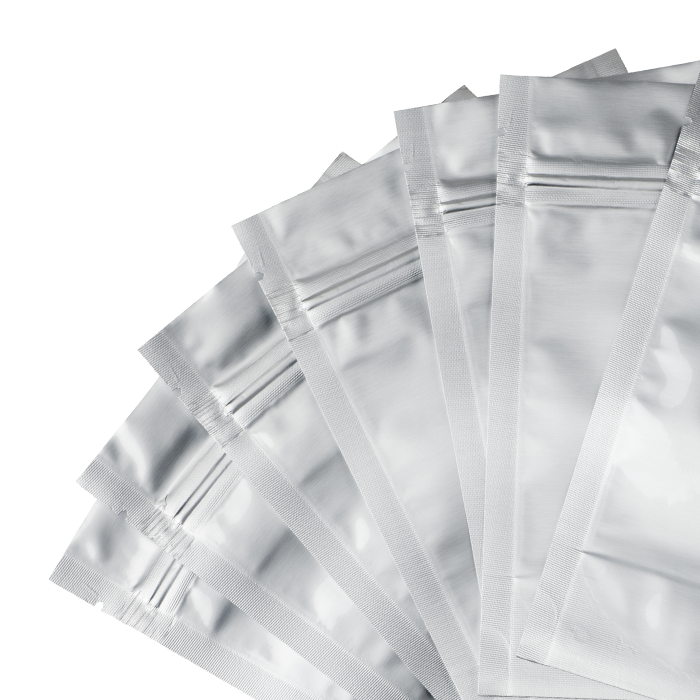 Poly mailer bags used for shipping products by mail spread out on a white background.