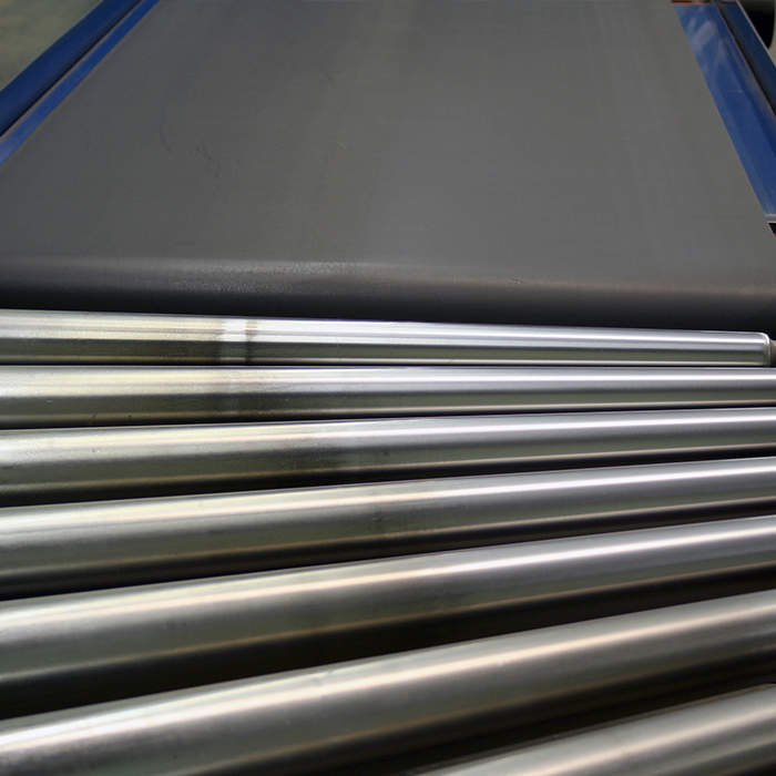 Powered Roller packaging conveyor system attached to a Powered Belted conveyor system.