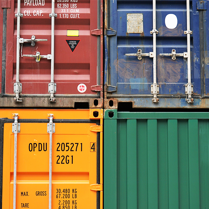Coloured train shipping containers stacked on top of each other