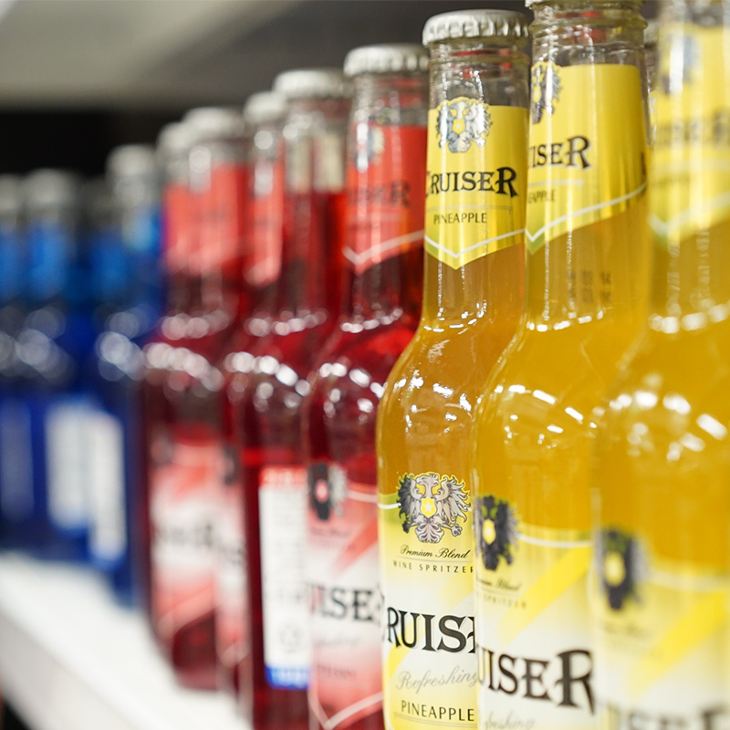 multiple alcoholic beverages on store shelves
