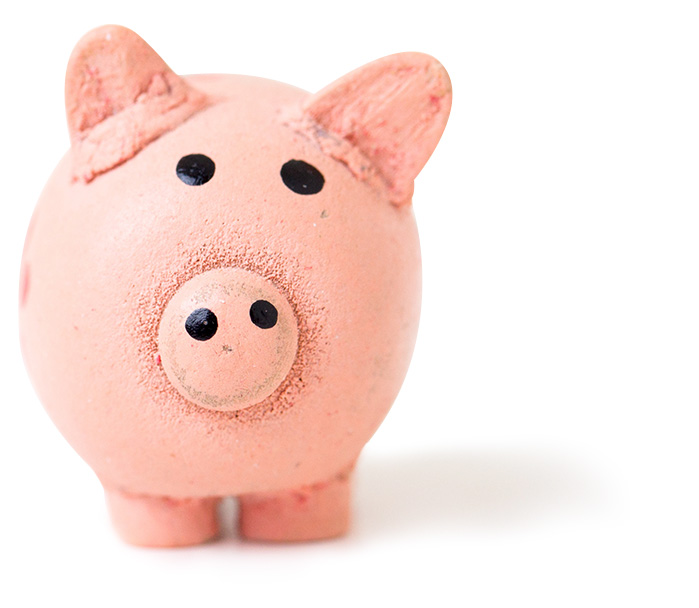 pink clay piggy bank with painted on black eyes isolated on white background