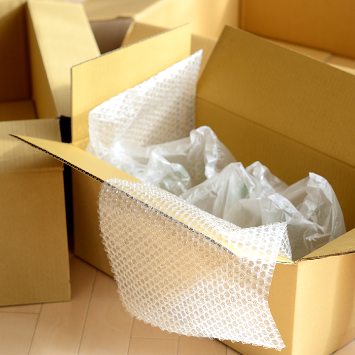 void fill packaging bubble wrap and air pillows inside cardboard box