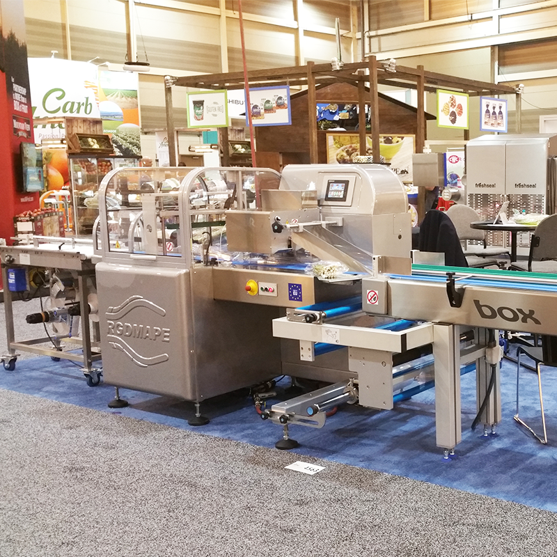 crawford packaging booth at pma with an RGD flow wrap machine and top seal machines