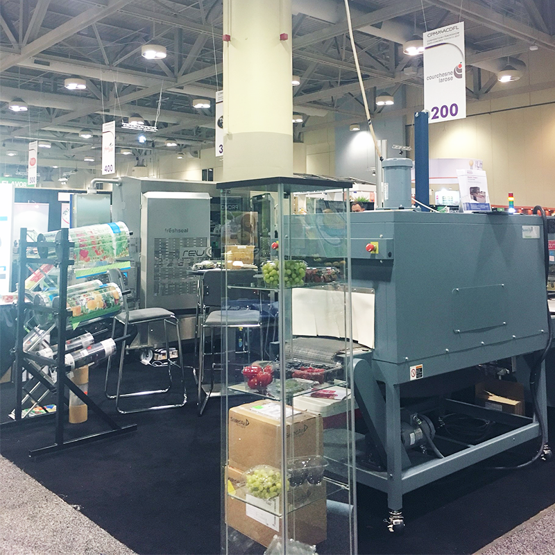 crawford packaging booth at cpma 2017 with rolls of packaging film and shrink wrap machine