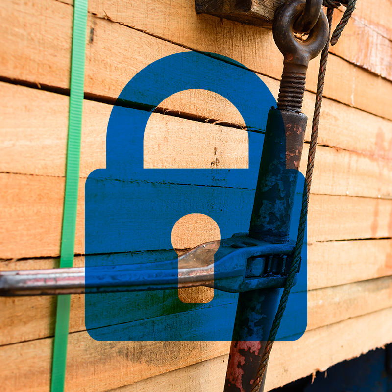 blue icon of padlock on top of close of up photo of lumber materials on transport truck