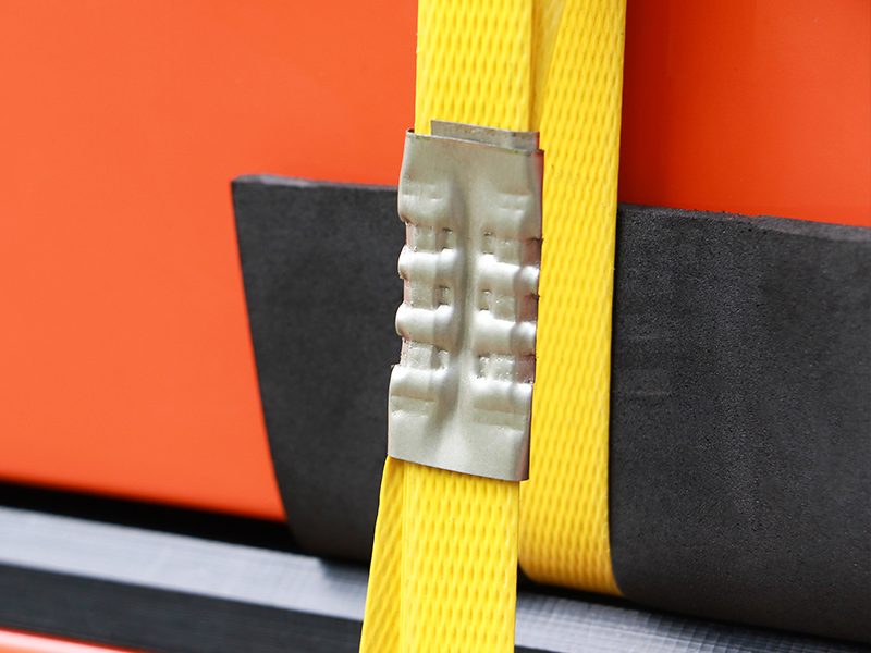 plastic strapping holding together bright orange coloured shipment