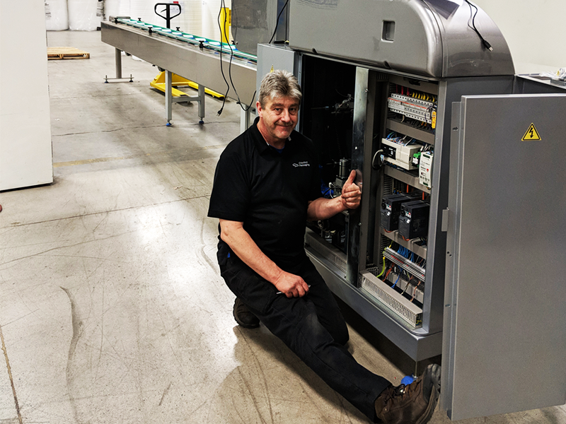 service technician making modifications to rgd mape vr8 flow wrap machine