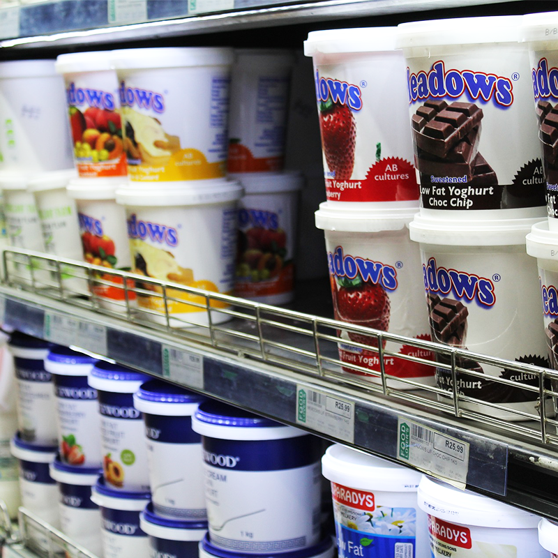 yogurt dairy products on retail shelf inside grocery store