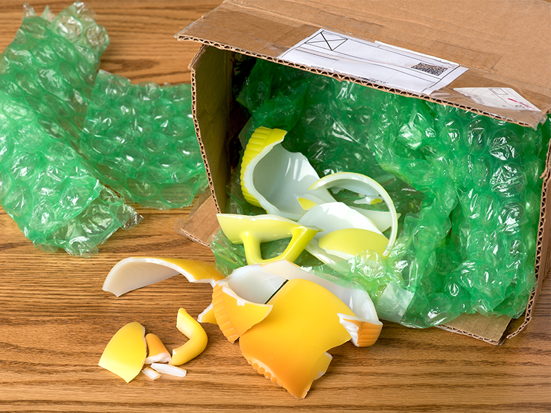 yellow glass product broken inside mailed package