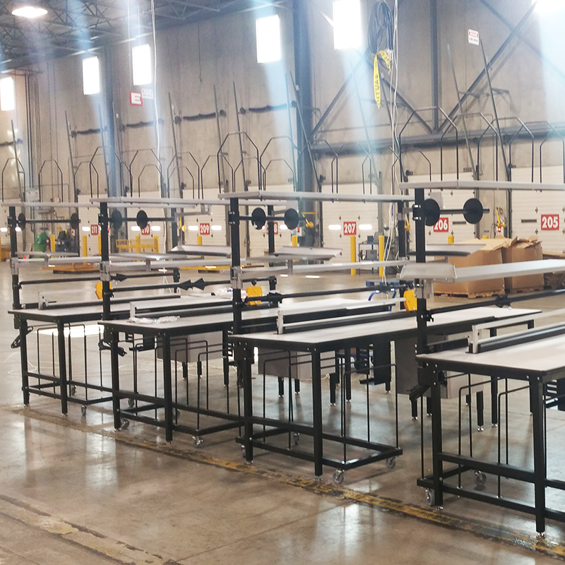 packaging stations in a row inside warehouse facility near loading docks