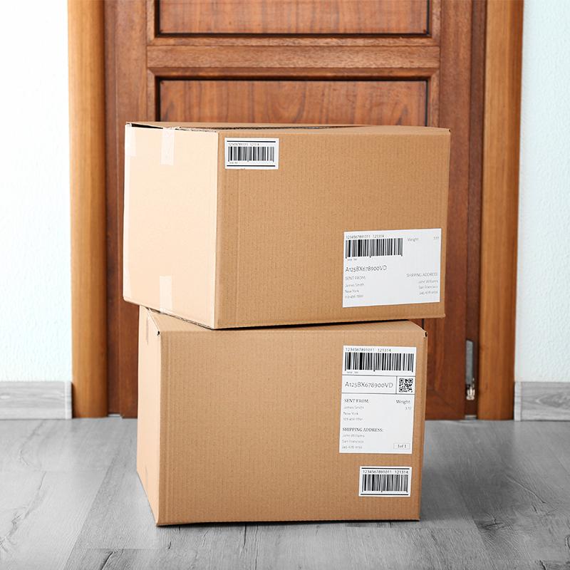 2 large cardboard parcels stacked at front door