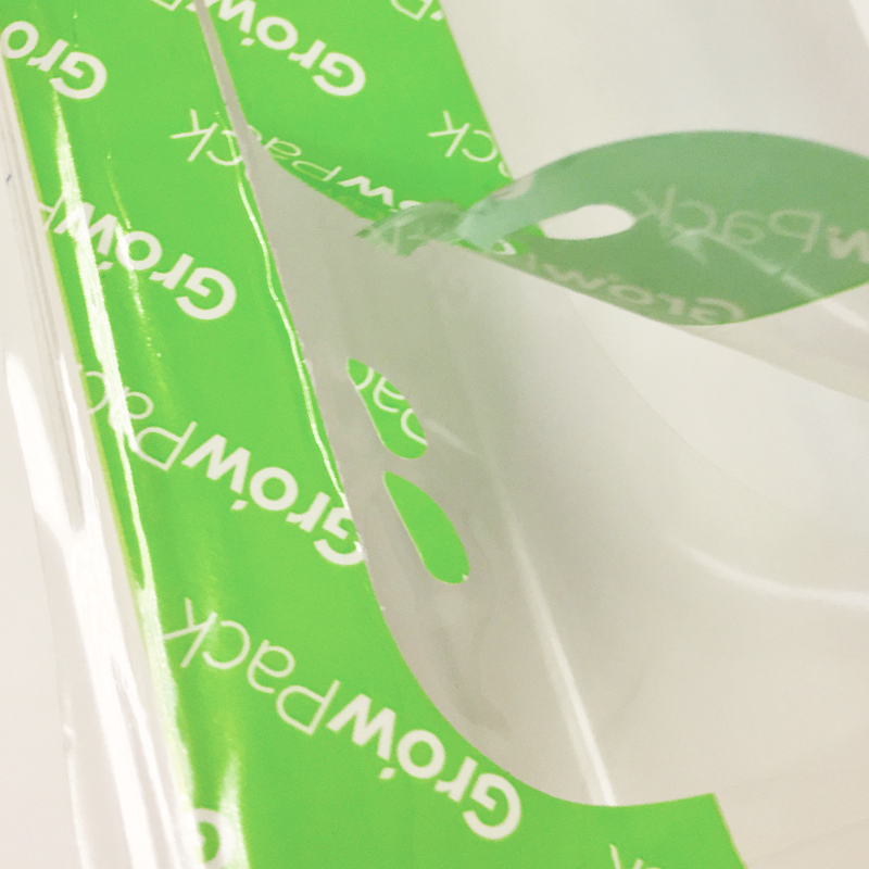 tamper evident technology on green and white patterned top seal film