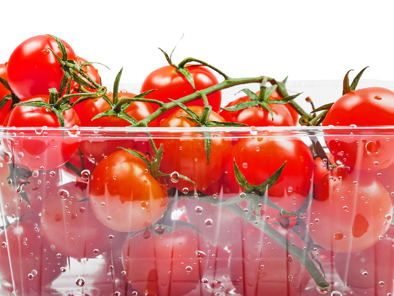 washed cherry tomatoes in clear plastic tray