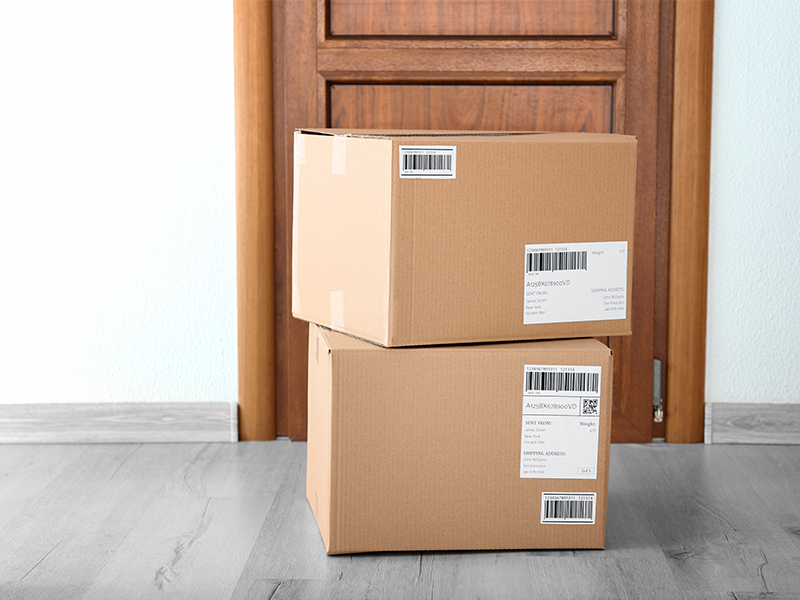 stack of two large shipping boxes on doorstep