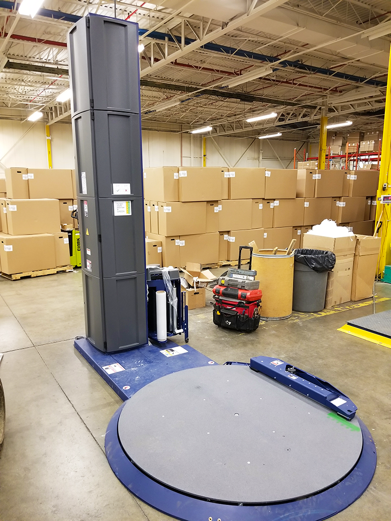lantech q-300xt being installed at plastic manufacturer's facility