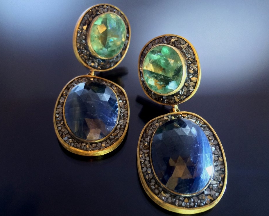 Earrings with a large deep blue tourmaline centrepiece and green tourmaline top, surrounded with crushed black diamonds.