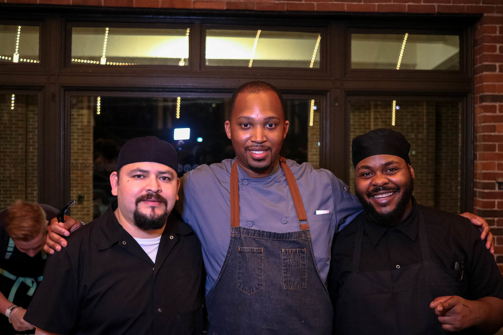 Chef Cedric Harden (center) of River Roast and the crew